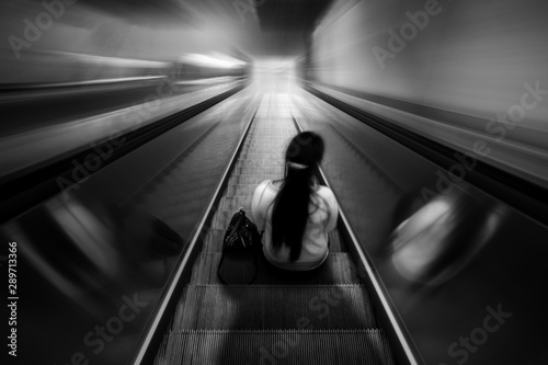 Pinturas sobre lienzo  Lonely woman sitting on an escalator