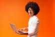 Leinwanddruck Bild - Millennial african guy working on laptop online, using internet