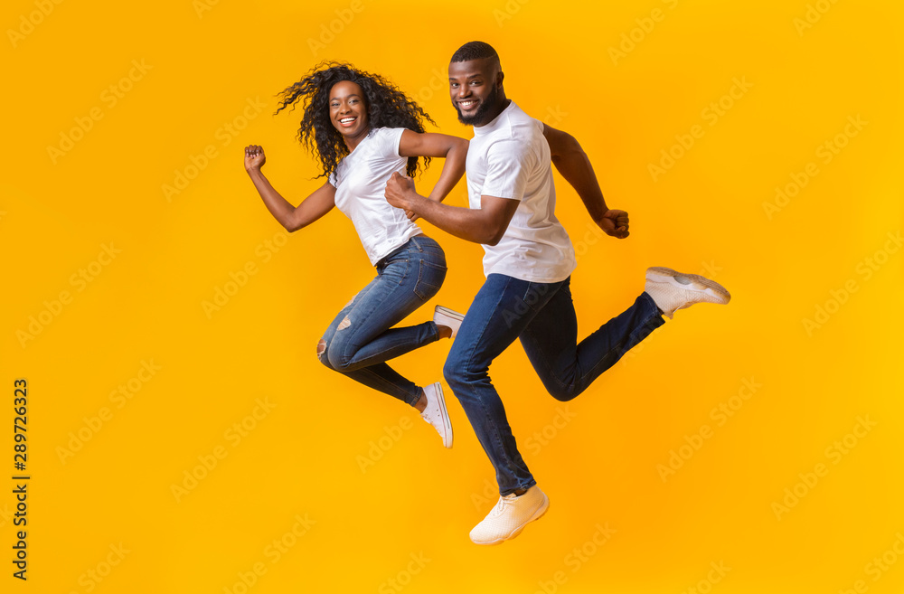 Fototapety, obrazy: Playful african couple is running in the air
