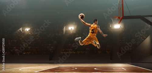 Basketball player on basketball court in action Canvas Print