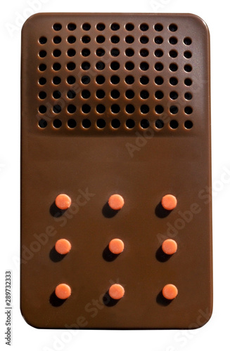 Photo  Isolated handheld device with blank orange buttons.