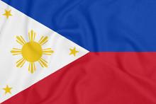 Flag Of Philippines On Textured Fabric. Patriotic Symbol