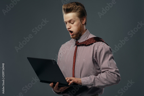 Obraz Strong wind blowing on man with laptop - fototapety do salonu