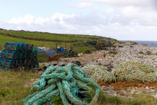 Industrial Fishing Beach With Lobster Pots, Rope And Fishing Equipment