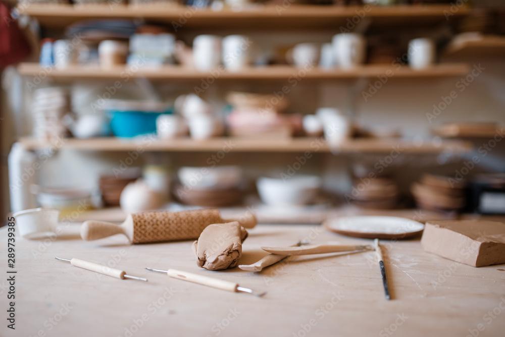 Fototapeta Plottery equipment on wooden table in workshop