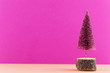canvas print picture - Christmas tree on pastel colored background. Christmas or New Year minimal concept.