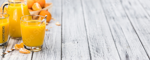 Foto op Aluminium Sap Homemade Tangerine Juice on a wooden table (selective focus)