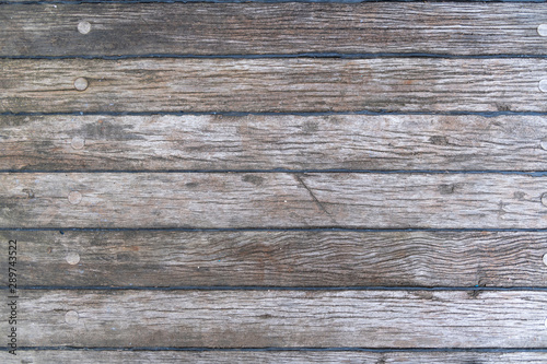 Photo sur Toile Navire Grey wooden background - old teak deck
