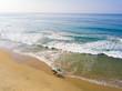 canvas print picture - Drei Surfer von oben am Meer