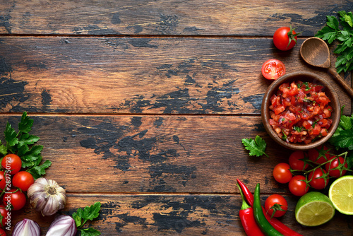 Tomato salsa (salsa roja) - traditional mexican sauce  with ingredients for making Fotobehang