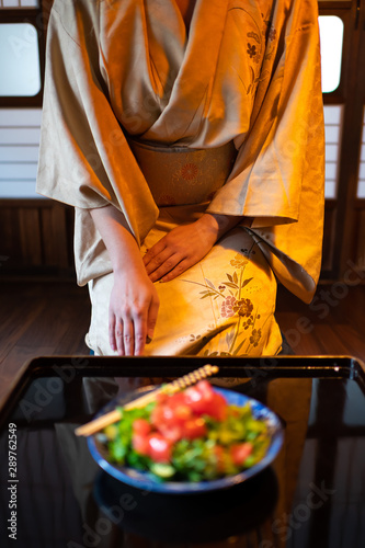 Fotografie, Tablou  Young woman in kimono, obi seiza sitting at traditional Japanese house or ryokan