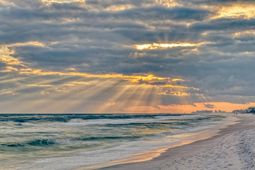 Panel Szklany Do Spa Dramatic pastel light sunset with sun rays in Santa Rosa Beach, Florida with Pensacola coastline coast cityscape skyline in panhandle and ocean
