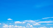canvas print picture - Beautiful blue sky and white cumulus clouds abstract background. Cloudscape background. Blue sky and fluffy white clouds on sunny day. Nature weather. Bright day sky for happy day background.