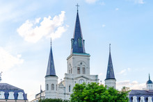 Old Town Street In Louisiana Town City With St Louis Cathedral Church On Sunny Day At Jackson Square In New Orleans, Louisiana Against Blue Sky