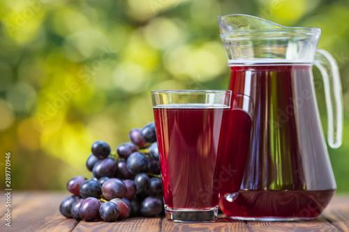 Fototapeta grape juice in glass and jug obraz