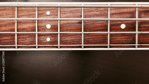 Spoed Foto op Canvas Muziekwinkel bass guitar neck . color background. closeup