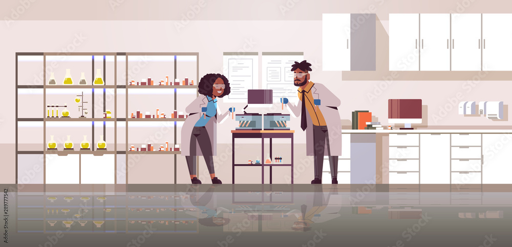 Fototapety, obrazy: scientists couple holding test tubes with blood samples african american man woman in uniform using analyzer machine science medicine concept modern laboratory interior full length horizontal