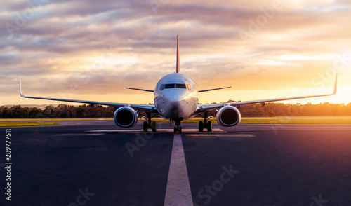 Sunset view of airplane on airport runway under dramatic sky in Hobart,Tasmania, Australia Canvas Print