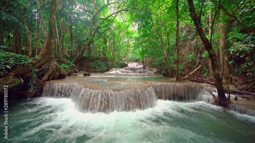 Huay Mae Khamin Waterfall with trees. Nature landscape of Kanchanaburi district in natural area. it is located in Thailand for travel trip on holiday and vacation background, tourist attraction. - 289780372