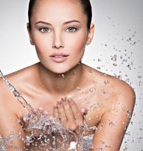 Caucasian Woman Washing Face W...