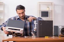 Young Engineer Repairing Music...