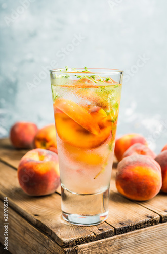 Gin based cocktail with peaches and thyme Canvas Print