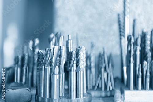 The various type  cutting tools of CNC machine on the stock shelf  in the light blue scene Fototapet