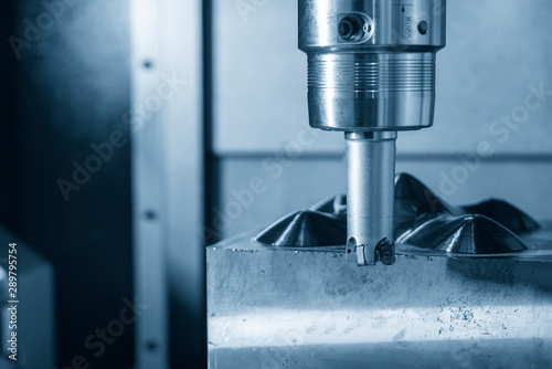 Obraz The CNC milling machine rough cutting the mould parts with the indexable radius endmill tools. The mold and die manufacturing process by machining centre with the indexable tools. - fototapety do salonu