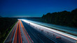 canvas print picture - Long exposure of motorway at night - Harvest moon