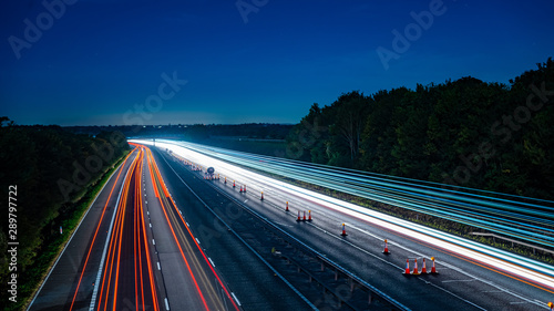 Montage in der Fensternische Nacht-Autobahn Long exposure of motorway at night - Harvest moon