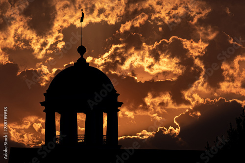bright sky at sunset and silhouette of a 19th century tower Poster Mural XXL