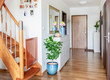 canvas print picture - home hallway with wooden floor, white furniture and mirror