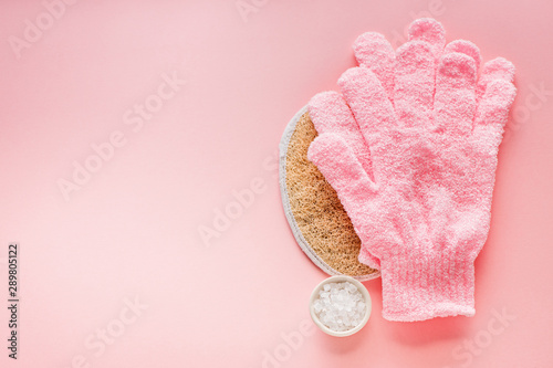 Cuadros en Lienzo Exfoliating massage glove for shower, sea salt and washcloth on a pink backgroun