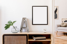 Modern Scandinavian Home Interior With Mock Up Photo Frame, Design Wooden Commode,  Big Cement Letter, Tropical Leaf, Gray Sofa And Personal Accessories. Stylish Home Decor. Template. Ready To Use.