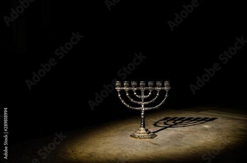Photo  Low key image of jewish holiday Hanukkah background with menorah on dark toned f