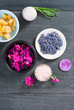 canvas print picture - pink linaria flowers and bath salt, dried lavender buds on black wood table