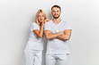 canvas print picture - Young happy cheerful couple in white t-shirts posing to the camera on white background.fashion, beauty, people concept