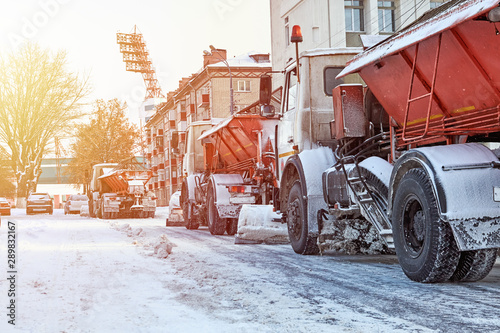 Snow plow removing snow from city road Canvas Print