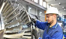 Workers Manufacturing Steam Tu...