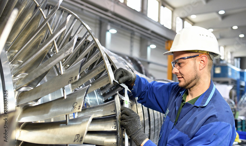 Obraz workers manufacturing steam turbines in an industrial factory - fototapety do salonu