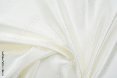 Fotografie, Obraz  Delicate satin draped fabric white texture for festive backgrounds