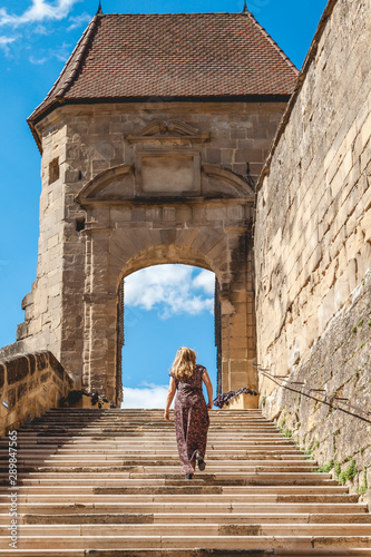 Fotografie, Obraz woman in a long dress is climbing the steps of the abbey of Saint Antoine