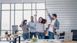 Leinwanddruck Bild - group of creative designer dancing in office with relax feeling and glad about good success news of project at modern office.business day work lifestyle.