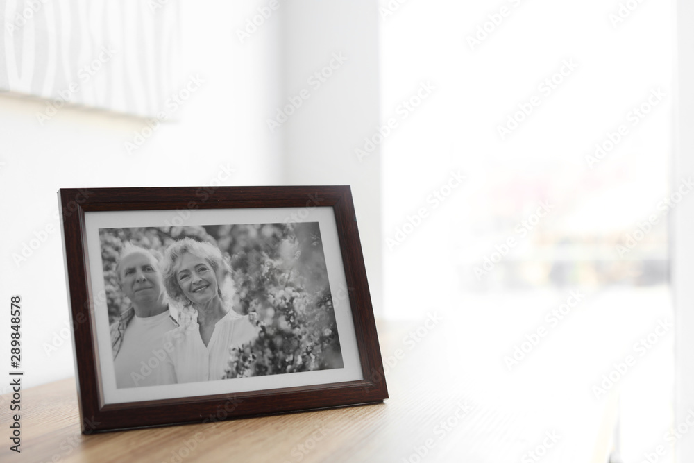 Fototapeta Portrait of senior couple in frame on table indoors. Space for text