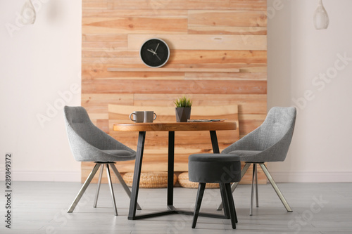 Stylish room interior with round table and comfortable chairs Canvas Print