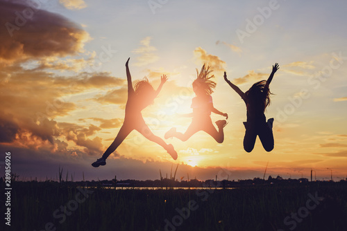 Concept of female friendship.Happiness friends at sunset time. Wallpaper Mural