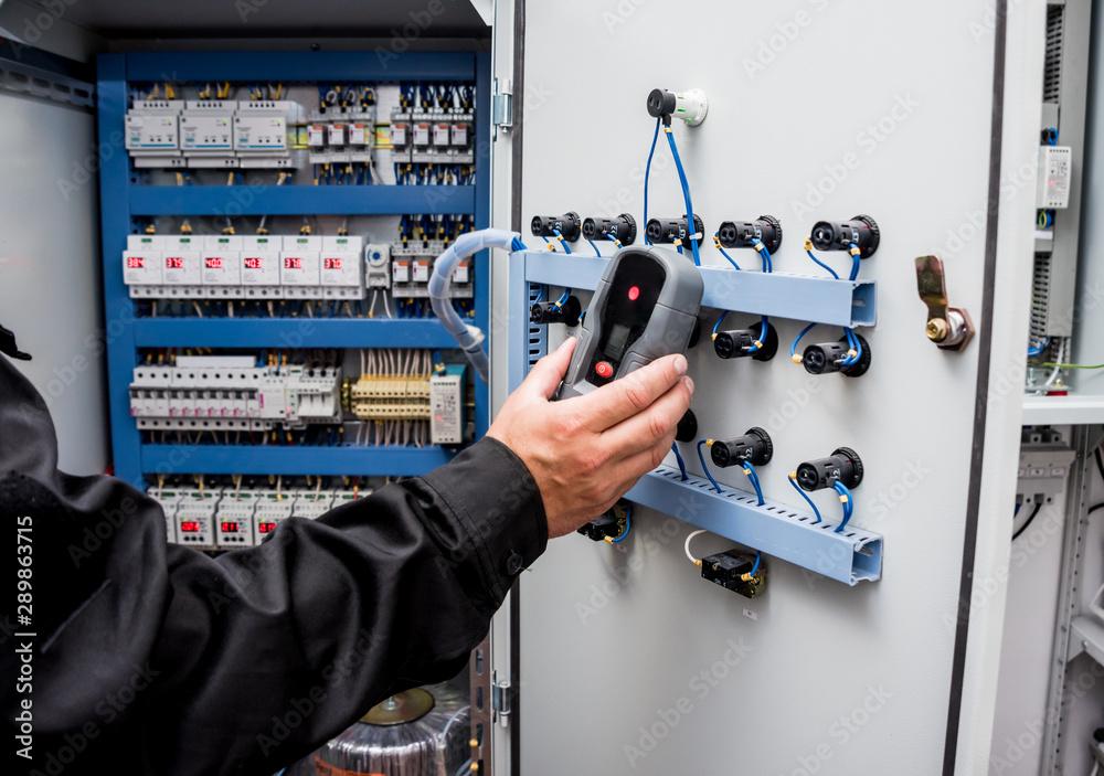 Fototapeta Electrical measurements with multimeter tester
