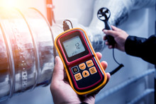 Technician Use Hand-held Anemometer Measuring Air Flowing Measurement, Wind Speed And Pressure.