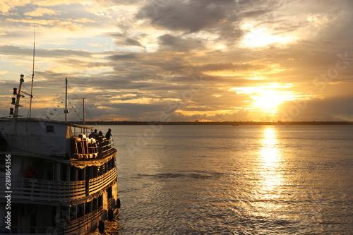 Photo Sunshine sunrise amazonia river brazil boat