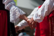 Closeup Of Hands Of Dancers With Alsatian Costume In The Street